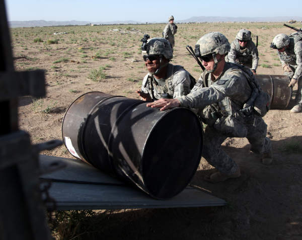 U.S. Army Soldiers from Charlie Company, 3rd Battalion, 187th Infantry Regiment, 3rd Brigade, 101st Airborne Division, push barrels of fuel during a fuel drop at Forward Operating Base Waza Kwah, Paktika Province, Afghanistan,  July 11, 2010. (U.S. Army Photo by Sgt. Jeffrey Alexander/Released)